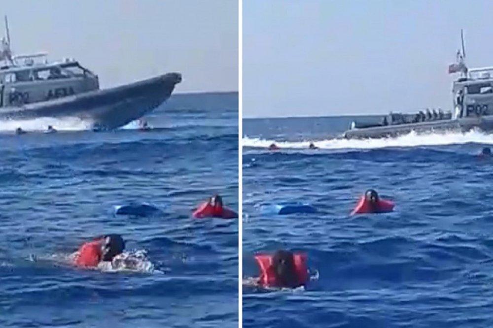 Nave militare maltese sfreccia fra migranti in acqua